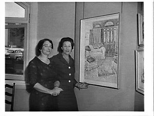 Treania Smith and her partner, Mary Killen, (?) with a Grace Cossington Smith painting to be sent to New Zealand, Macquarie Gallery, Sydney