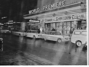 Promotion for Triumph Heralds outside the Century Theatre advertising the film Summer of the seventeenth doll