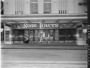 Night exterior of the Century Theatre advertising the film Sons and lovers