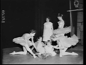 Handicapped children and ballerinas from the New York City Ballet tour on the stage of the Empire Theatre