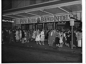 Exterior of the Century Theatre advertising the film Beloved infidel