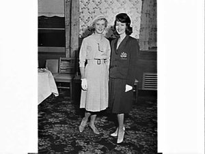Betty Cuthbert, runner, and unidentified woman model the Australian team uniforms for the 1960 Rome Olympic Games, Hotel Australia