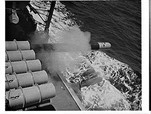 HMAS Parramatta firing and recovering a torpedo at sea