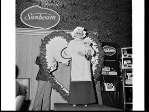 Fashion parade and meal to promote Sunbeam appliances, Amory Gardens reception rooms, Ashfield