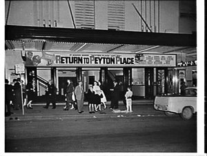 Night exterior of the Century Theatre, 1961, advertising the film Return to Peyton Place