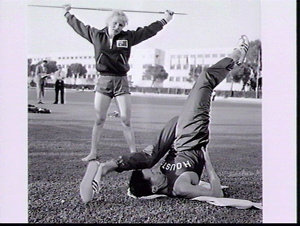 Runner Alan Lawrence and javelin thrower Anna Wojtaszek-Pazera limber up during training spell, Rome Olympic Games 1960