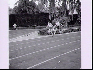 Runners Betty Cuthbert and Marlene Mathews practise baton-changing for the relays, Rome Olympic Games 1960