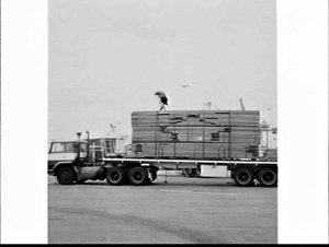 Unloading timber from a semi-trailer using a fork-lift to be loaded onto an Overseas Containers (OCL) container ship at the Australian National Line terminal, Botany