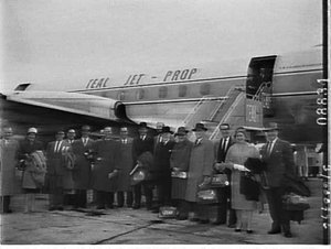 Journalists and radio industry party boarding TEAL, resumption of Lockheed Electra service to Wellington, Mascot