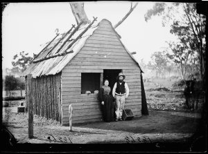 Couple outside a small store (also their dwelling ?), Gulgong area