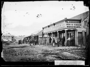 Clarke Street scene, Hill End, looking north from George Hodgson's iron, timber & wine merchant business, (with Merlin's photographic laboratory cart in the background)