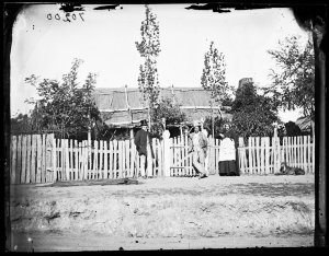 Two men and a woman with house, Hill End