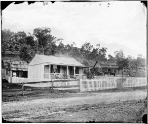 Weatherboard house with picket fence, Trunkey