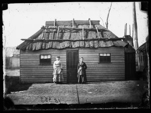 Two women outside house next door to the West Coast Hotel (?), Gulgong
