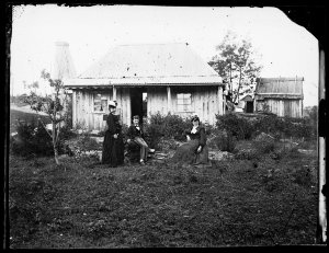 Two women and a boy with house, Hill End