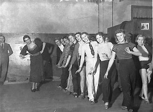 Choreographer Frances Scully discusses dance routines with dancers