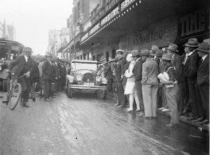 Miss Australia Beryl Mills drives away from the Haymarket Theatre