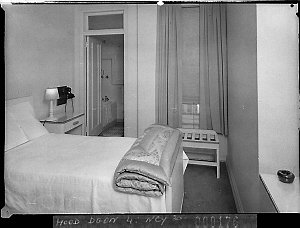 One of the bedrooms; showing bathroom and twin beds, Wentworth Hotel (Brewster & Manderson, architects)