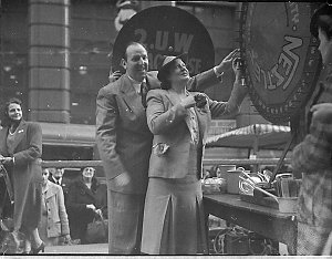 2UW stall in Martin Place, Anzac House; Gladys Moncrieff (?) and Bob Dyer
