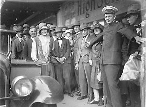"""Haymarket Theatre commissionaire holds back the crowds for the first """"Miss Australia"""", Beryl Mills of Western Australia"""