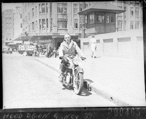 Salesman demonstrating a Francis-Barnett motorcycle