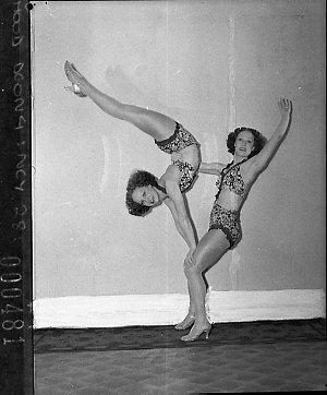 Turner twins, dancers, demonstrate Mignon hosiery