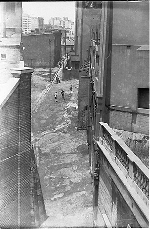 Unidentified lane in city of Sydney [probably The Rocks with stairs related to Harbour Bridge construction]