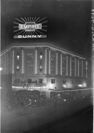 """Crowd around the foyer at night for opening of """"Sunny"""", Empire Theatre"""