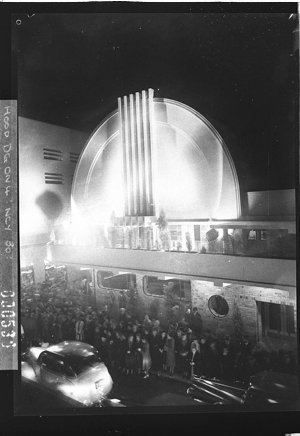 A night picture of the front of the Minerva Theatre (taken for Building Publishing Co)