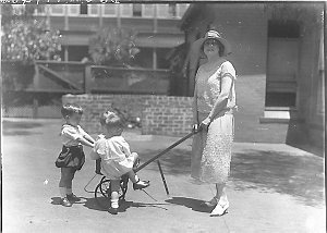 Musical comedy star Dorothy Brunton with three small children and a stroller