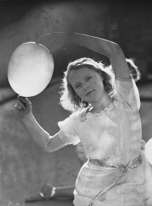 A girl competitor dancing with a balloon
