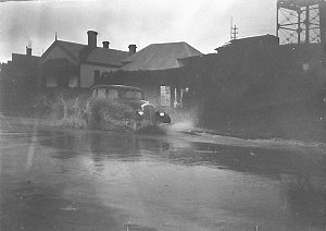Sam Hood's 1934 Willys 77 in a flooded street