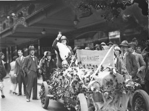 Gladys Moncrieff waves to the crowd during a Remembrance Day fund-raising from the Seneschal car of Harold S. Darke, Advertising Manager, Holeproof Hosiery