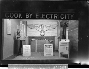 A Sydney County Council window display showing an electric stove and 'Cook by Electricity' sign
