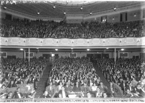 The crowded auditorium of the Empire Theatre