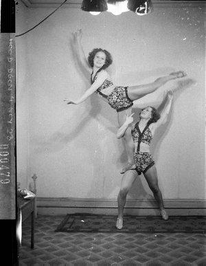Turner twins, acrobatic dancers, demonstrate Mignon hosiery