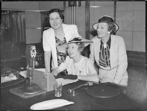 Miss Irene Purcell at 2UW microphone
