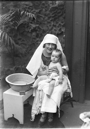 Musical comedy star Dorothy Brunton washing a baby