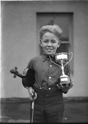 Young violinist and his trophy at Eisteddfod