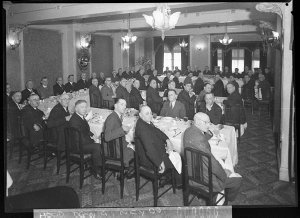 Presentation of an illuminated address to Stuart F. Doyle (Managing Director, Union Theatres Ltd.) by the Australian Cinema Pioneers; view of the diners at the official dinner