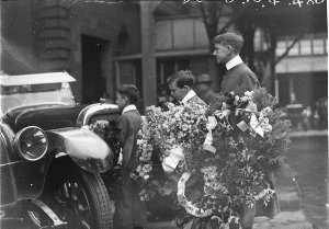 Wreaths being loaded onto the mourning cars at Sir Edgeworth David's funeral