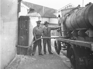 An early Shell refuelling tanker; (note solid rubber tyres).