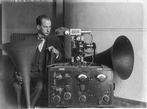 Charles Ward, sound engineer, fitting the sound-head to the projector of the De Forest Phonofilms' sound film system