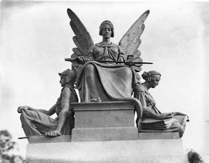 """Carved stone figures of a soldier, an angel and a scribe.  """"To Our Glorious Dead""""."""