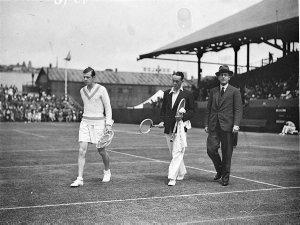 Christian Boussus (France, left) and Vivian McGrath (centre) enter centre court with Bryan Fuller, President NSW Lawn tennis Association, Nov 1934