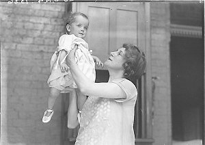 Musical comedy star Dorothy Brunton holding a small child
