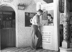 A young soldier signs a pledge for war bonds and receives a free double pass at the Capitol Theatre