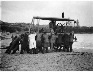Raising a sunken power barge from harbour bed [i.e. Divers and their helpers with their diving rig, Malabar wreck, Maroubra]