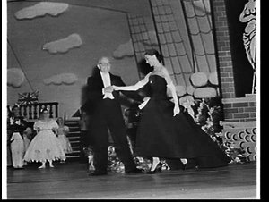 Margot Fonteyn in a Dior evening gown takes a curtain call on the opening night of her Sydney ballet season at the Empire Theatre