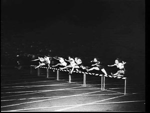 Shirley Strickland of Australia clears the last hurdle to win the 80 yds. hurdles from N. Thrower (Aust.-2nd) and E. Wynter (S.Africa-3rd) at the British Empire & Commonwealth versus USA 1956 athletic meet